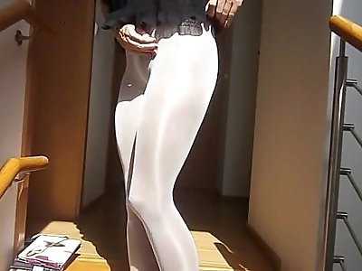 Sexy woman with sexy legs putting on  layers of pantyhose