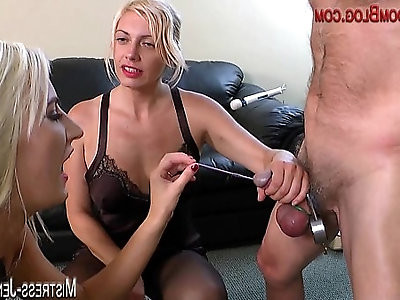 Two femdom Mistresses ruin a cock