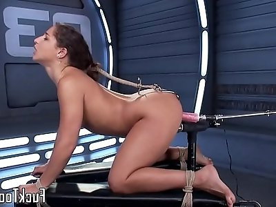 Restrained babe getting her pussy toyed by dildo machine