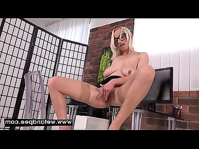Saggy breasted blonde peeing in her office