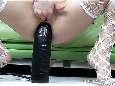 Petite blonde Holly Hanna gapes her ass with dildos