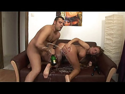 dirty tramp takes a champagne bottle in her ass