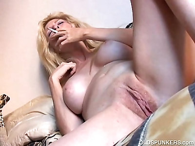 Super sexy old spunker has a smoke and plays with juicy pussy