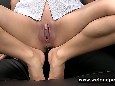 Brunette has an accident on the couch
