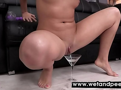 Hot brunette covers herself in piss and masturbates