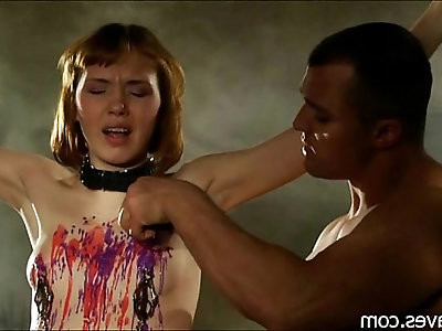 a beautiful redhead with small tits being spanked and fucked