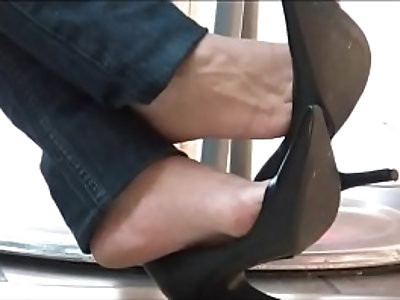 Candid Shoeplay Dangling in Cafe Black Pumps